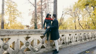 SLOW MOTION of Happy couple in autumn park walking and having fun. Romance and relationship