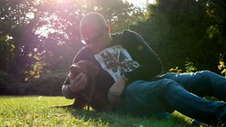 Slow motion of spending family quality time in the park with dog