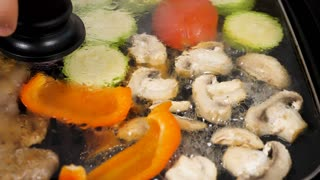 Slow motion of steaming and smoking vegetables and meat in a grill