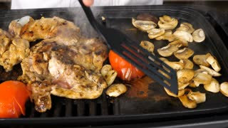 Slow motion of steaming and smoking vegetables and meat on a grill