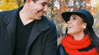 Slow motion. Portrait of beautiful couple smiling and laughing in autumn park. Love and romance