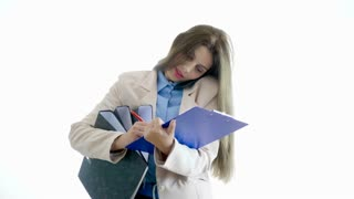 Stressed Young businesswoman over white background talking on the phone and droping the folders. Communication and corporate