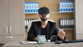 Technology VR - Mature businessman wearing virtual reality technology googles. The businessman in sliding and searching through virtual reality