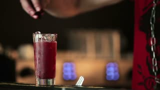 Barman adds berries and sparkling water