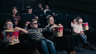 Children are watching 3D movie in the cinema