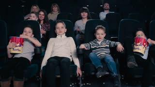 Children watch the movie in the cinema