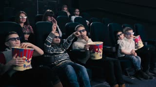 Five boys watching the movie in the cinema
