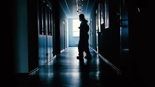 Lab worker is dancing in the corridor