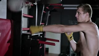 Man boxing in boxing bandages