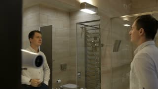 Man combed in the bathroom at the hotel