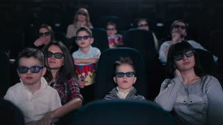People are watching the movie in the cinema