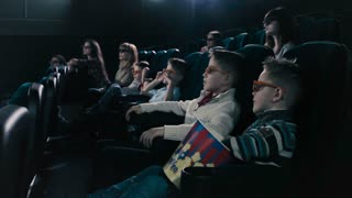 People watching a horror movie in the cinema