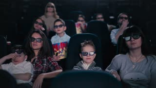 People watching the film in the cinema