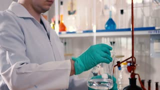 Pour the liquid from the flask into a beaker