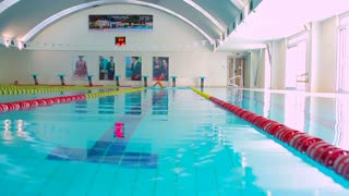 Professional swimmer training to swim breaststroke in the pool