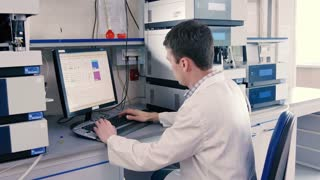 Scientist working at a computer in the lab