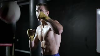 Slow motion training with a punching bag
