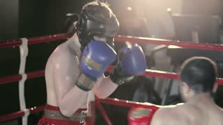 Sportsmen are boxing in the ring