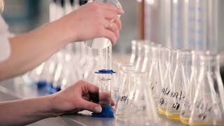 The volumetric flask is poured into a liquid