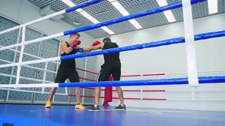 Two boxers sparring in the ring