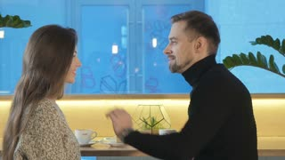 A man touches his girlfriend's hair on a date