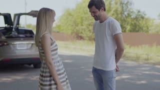 A young guy scoffs at his girlfriend when she scolds him