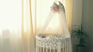 Adorable baby is sleeping in a crib at home