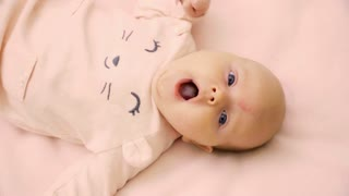 Adorable newborn baby on bed