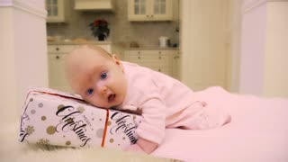 Adorable two-month baby on the Christmas gift