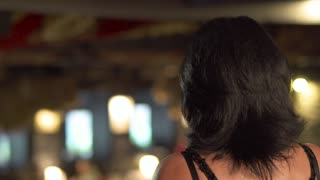 Adult beautiful woman singing at the stage in restaurant