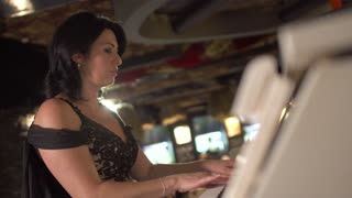 Adult lady plays piano