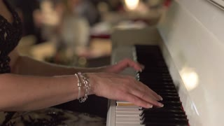 Adult woman plays piano