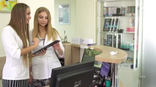 Adult woman visit clinic and fill the form at reception