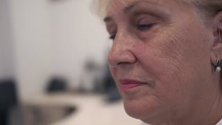 Adult woman with a hearing aid