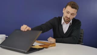 Angry boss with wooden ax finish the conversation on webcam