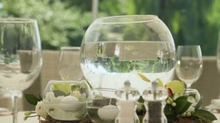 Aquarium with small golden fish at the table