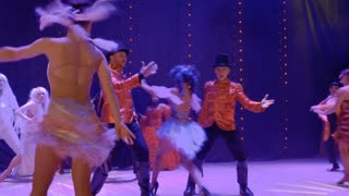 Artistic people dancing on stage in theatre