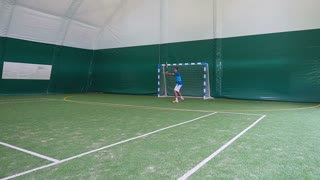 Attractive guy playing tennis on court in slowmotin