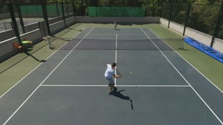 Attractive young man and woman play the tennis game