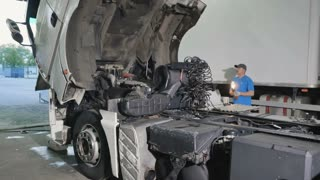 Auto mechanic wait when the cabin of truck down