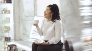 Beautiful brunette drinks coffee