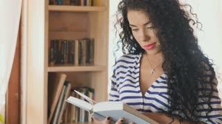 Beautiful brunette read book