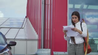 Beautiful furious businesswoman scatters paper