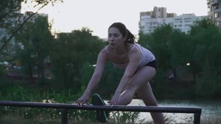 Beautiful girl doing exercise outdoors