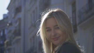 Beautiful girl in the city street
