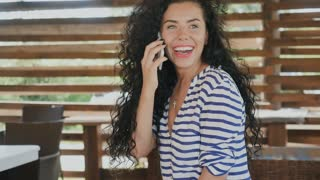 Beautiful girl laughing and enjoys the conversation on phone