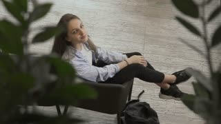 Beautiful girl relax in armchair
