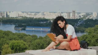 Beautiful girl relax with tablet at city background