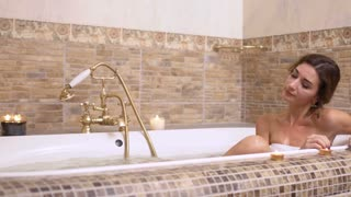 Beautiful girl with champagne relax in hot bath