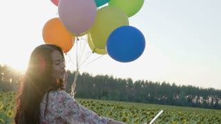 Beautiful lady takes selfie with balloons
